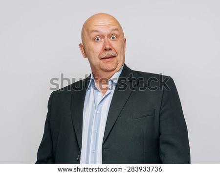 Senior man surprised portrait smiling in suit  - stock photo