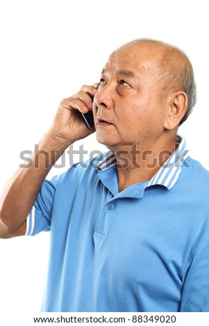 Senior man talking to cellphone. Isolated on white background.
