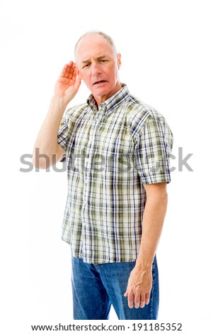Senior man trying to listen isolated on white background - stock photo
