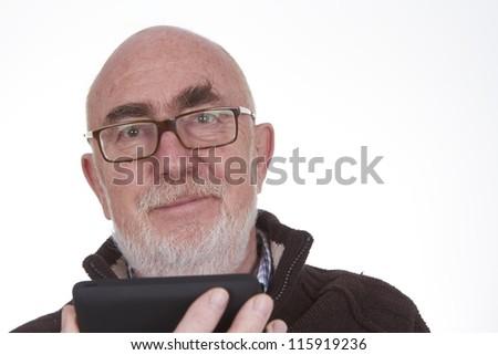 Senior man using a tablet computer - stock photo