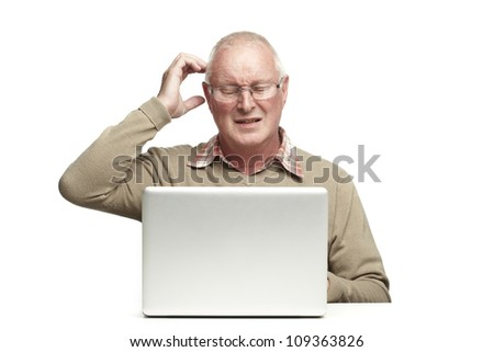 Senior man using laptop whilst looking confused, on white background