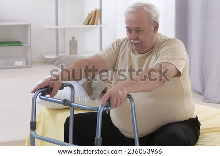 Senior Man Using Walking Frame - stock photo