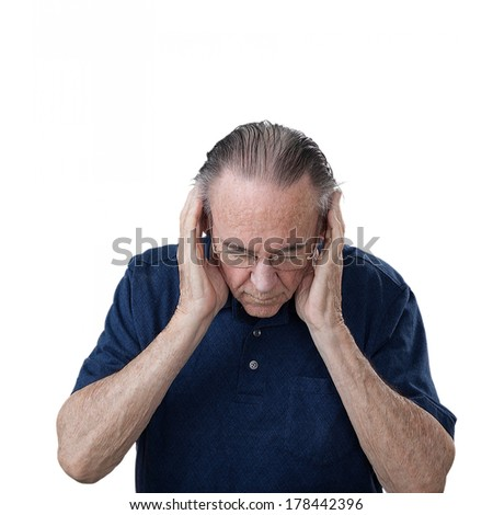 Senior man wearing blue shirt suffers from migraine headache. Isolated on white background.