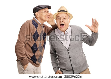 Senior man whispering something to his friend and laughing together isolated on white background