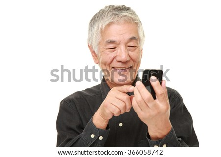 senior man with a smart phone  - stock photo