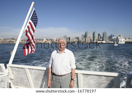 Senior man with american flag - stock photo
