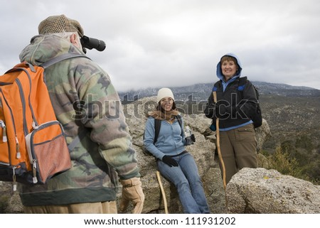 Senior man with binoculars on a hiking