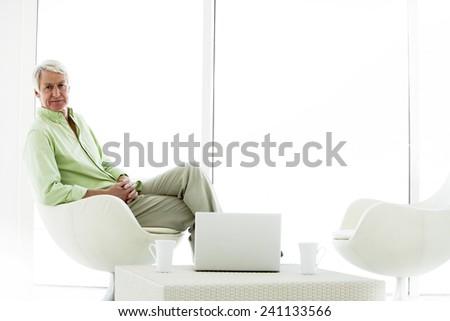 Senior man with computer - stock photo