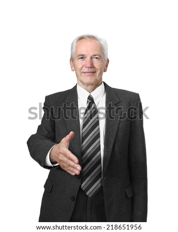 Senior man with friendly face gives his hand for handshake isolated on white background