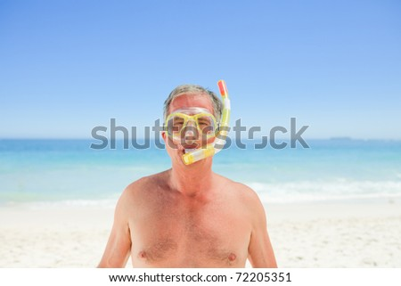 Senior man with his mask and his snorkel - stock photo