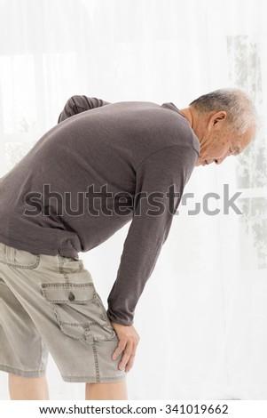 senior man with  knee pain - stock photo