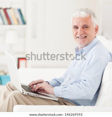 Senior Man With Laptop - stock photo