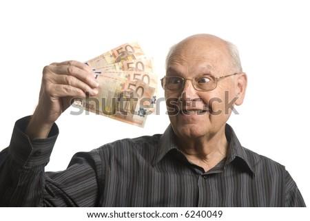 senior man with money isolated on white - stock photo