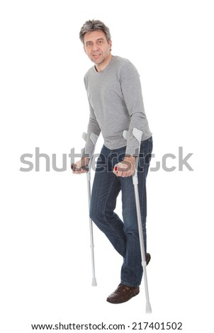 Senior man wolking using crutches. Isolated on white - stock photo
