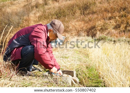 Senior man working in the field