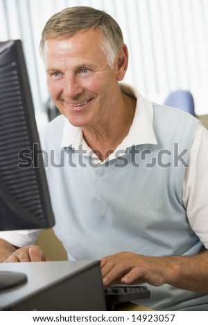 Senior man working on a computer - stock photo