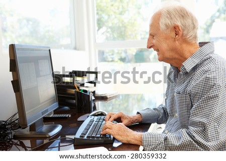 Senior man working on computer at home