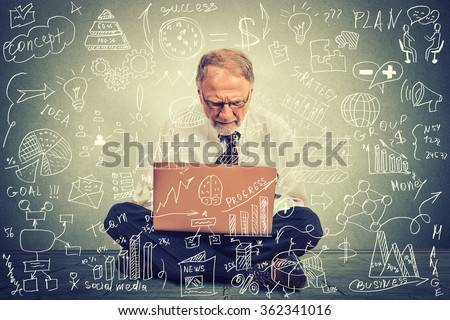 Senior man working on computer sitting on a floor in his office building future business strategy. Finance economy education concept. Data processing management