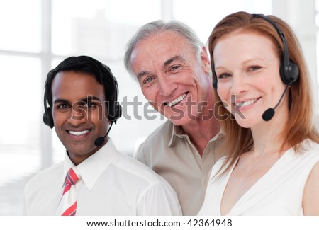 Senior manager checking his team work in a call-center - stock photo