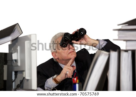 senior manager looking through binoculars and pointing with his finger