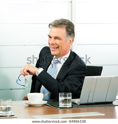Senior Manager or boss in meeting discussing new strategy - stock photo