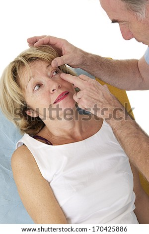 Senior medical check, up with focus on eyes examination  - stock photo