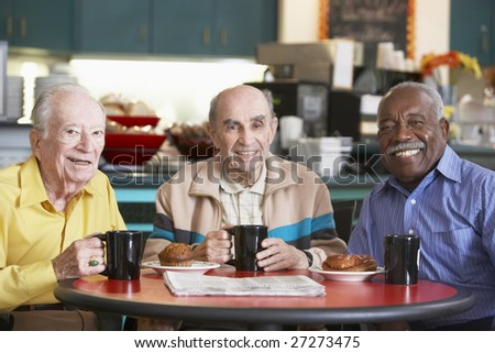 Senior men drinking tea together - stock photo