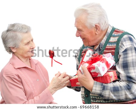 senior men give gifts  senior women on white background - stock photo