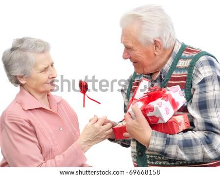 senior men give gifts  senior women on white background - stock photo