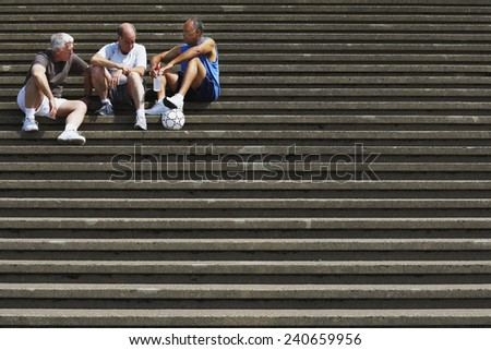 Senior Men Socializing on Steps - stock photo