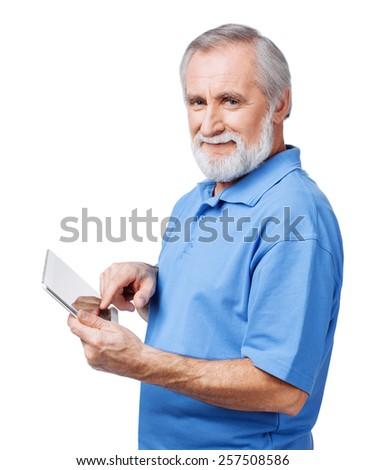 Senior men using digital tablet - stock photo