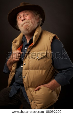 Senior outdoors man with hand in pocket - stock photo