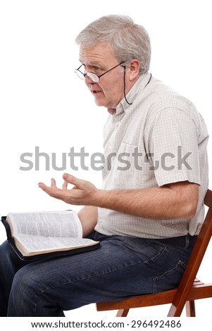 Senior pastor talking about the Word of God - stock photo