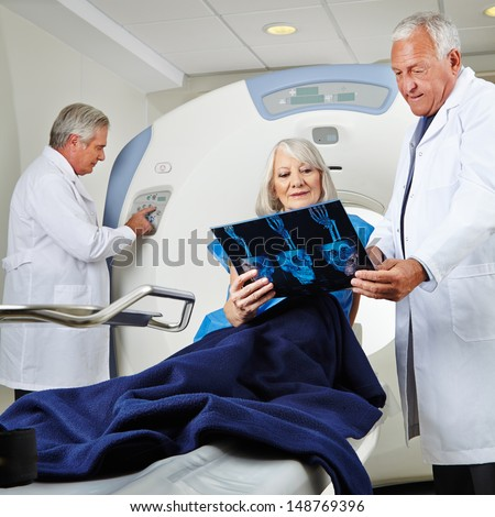Senior patient getting magnetic resonance tomography in hospital - stock photo