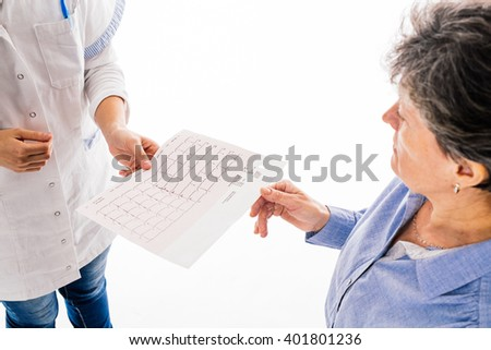 Senior patient handing EKG to doctor - isolated on white background - stock photo