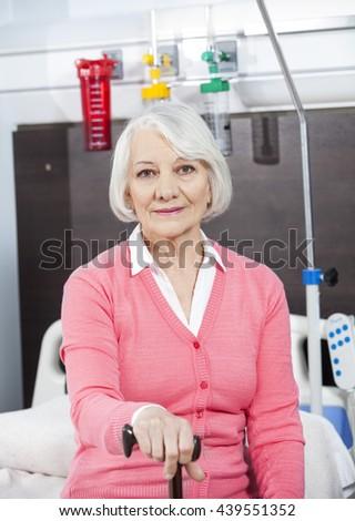 Senior Patient Holding Cane At Rehab Center - stock photo