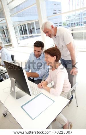 Senior people attending business training - stock photo