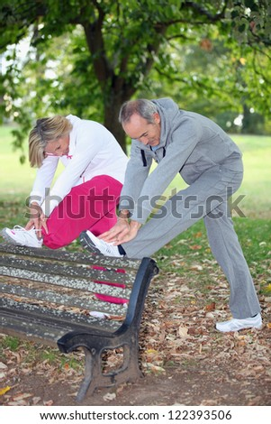 Senior people doing gymnastics - stock photo