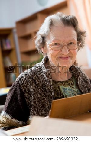 Senior people playing rummy - stock photo
