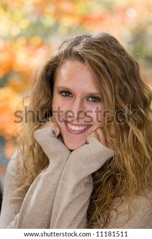 Senior portrait of beautiful high school senior girl at Mounds Park, Anderson, IN. - stock photo