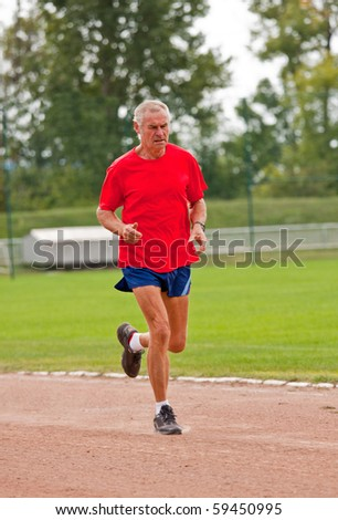 Senior runner while training for a competition - stock photo