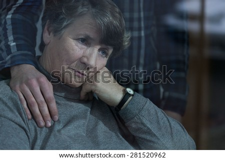 Senior sad woman is supported by her grandson - stock photo
