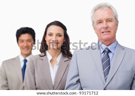 Senior salesman with his team against a white background - stock photo