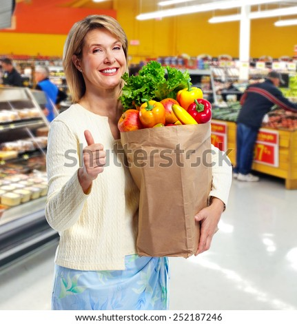 Senior shopping woman with grocery items. Healthy diet. - stock photo