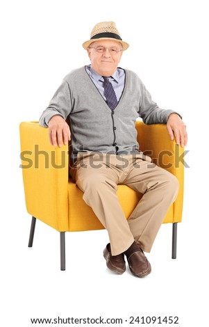 Senior sitting in a modern armchair and looking at camera isolated on white background - stock photo