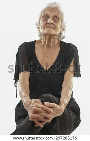 Senior smilling and looking at up . - stock photo