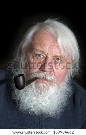 Senior, smoker with white beard and pipe - stock photo