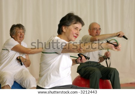 Senior Strength Group Workout at Fitness Center - stock photo