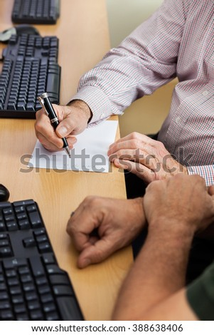 Senior Students Studying In Computer Class - stock photo