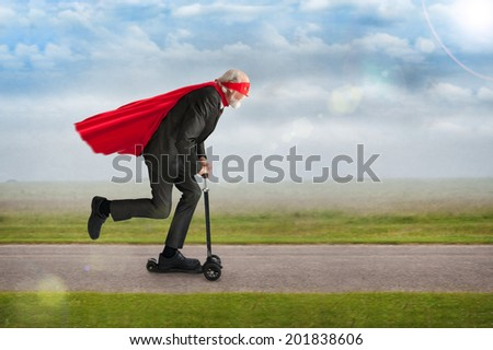 senior superhero man riding a scooter